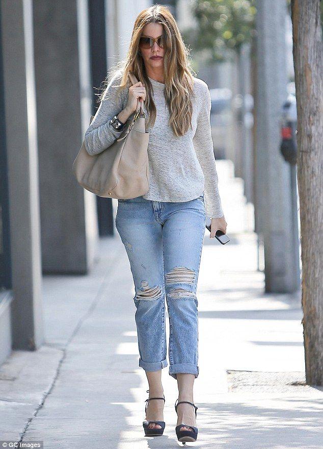 Sexy shopper: Sofia Vergara strutted around in stilettos as she indulged in some retail th...