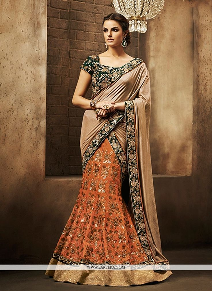 Style and design and trend will be at the peak of your elegance as soon as you dresses this orange faux chiffon designer saree. You will be able to see some intriguing patterns performed with emb...