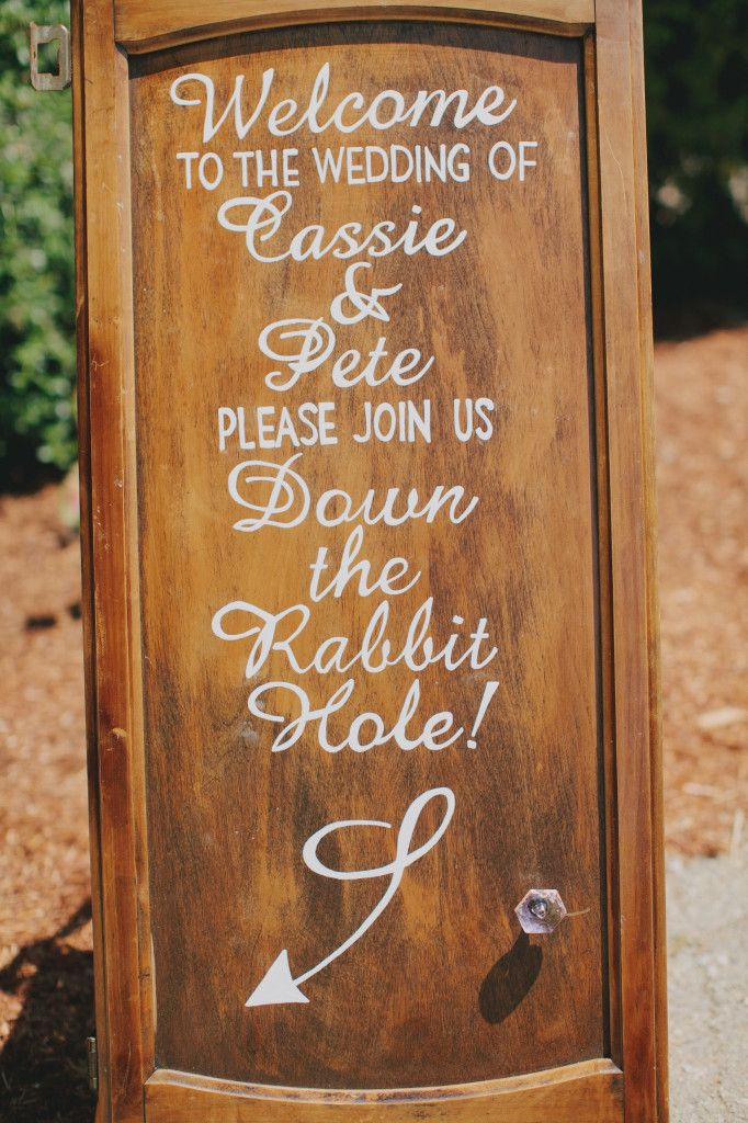 Welcome sign with an Alice in Wonderland twist | Kaella Lynn Events | Jake and Necia Photography #wedding #cupboard #diy