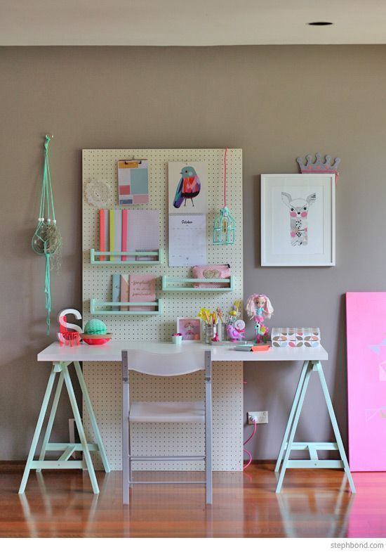 Blogger Petit & Small created this pastel-toned study space for her friend's daughter using a pegboard with tons of small details — check out the hanging calendar and caged lightbulb! MORE DIY: Brit Morin Talks DIY, Tech, and Following Your Passions   - HouseBeautiful.com