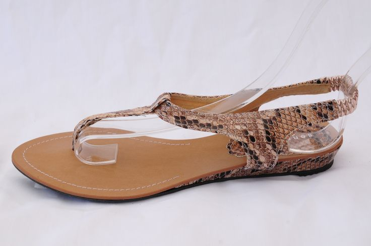 This Summers hottest trend: Snakeskin and more snakeskin! Oranges and tans will go great with these fabulous thong sandals!