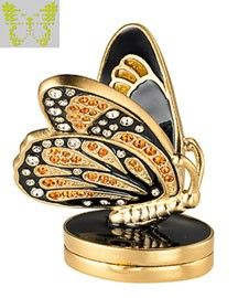 Estee Lauder Beautiful Bejeweled Butterfly Perfume Compact This monarch is fit for a queen. Resplendant in gleaming black enamel, orange and clear crystals and bright golden highlights, she is dramatically poised to take flight. Simply exquisite. The limited-edition collectible...See more »