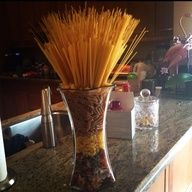 italian themed party ideas - Google Search - using different shaped pasta  in glass containers for centerpieces could be less expensive, and then add some small glasses with the breadsticks