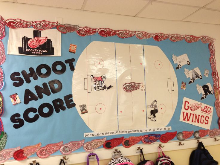 Accelerated Reading (AR) bulletin board. Students move hockey pucks along the ice when they earn points.