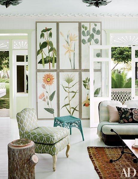 Botanical art by Natural Curiosities hangs in Casa Guava's bright living room | archdigest.com