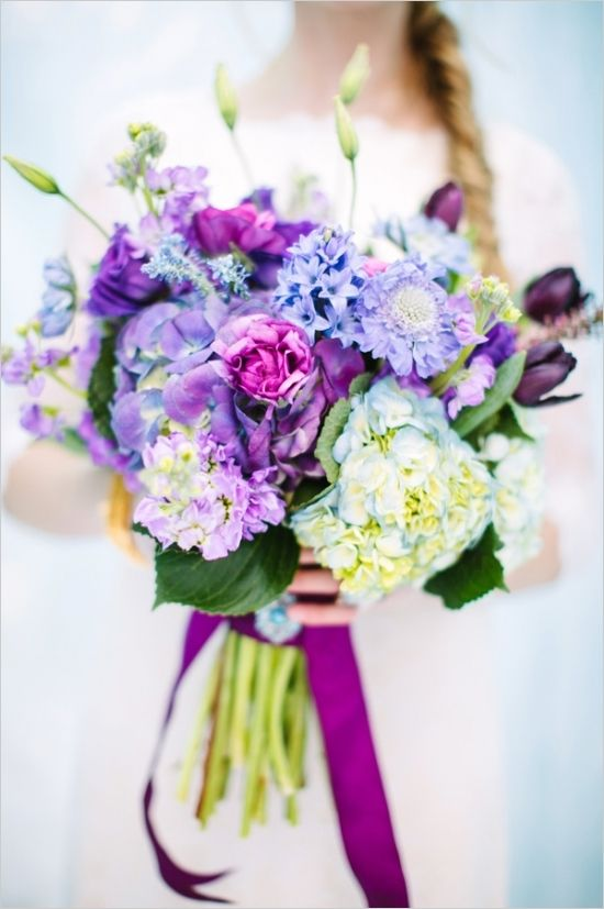 bright purple and icy blue bouquet by Calie Rose #bouquet #frozen #weddingchicks http://www.weddingchicks.com/2014/04/03/frozen-wedding-ideas/