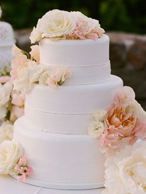 A Peach and Pink Flower Wedding Cake