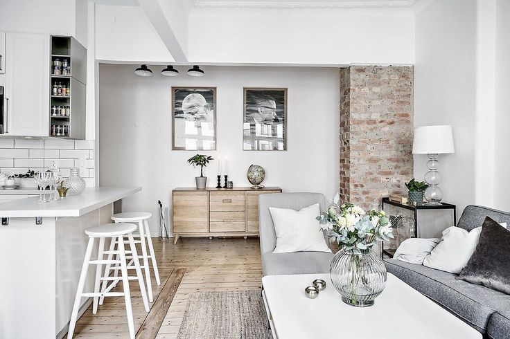 Decoración apartamentos pequeños: cocina integrada y detalles en ladrillo visto 9