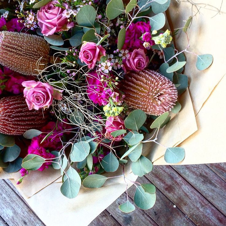 Banksias and roses with twiggy detail and dollar gum. Design by Bloom Tribe Perth