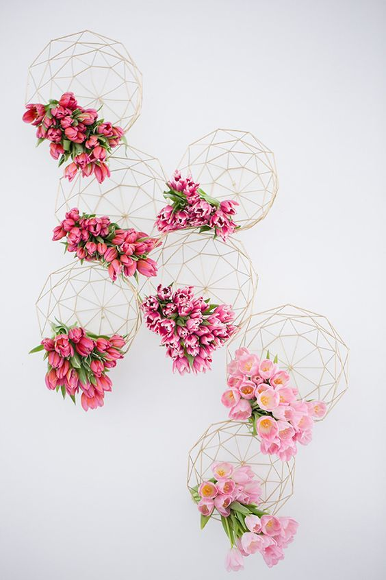 Shades of pink wedding inspiration with geometric designs as vessels bursting with tulips / http://www.deerpearlflowers.com/modern-himmeli-geometric-wedding-details/3/