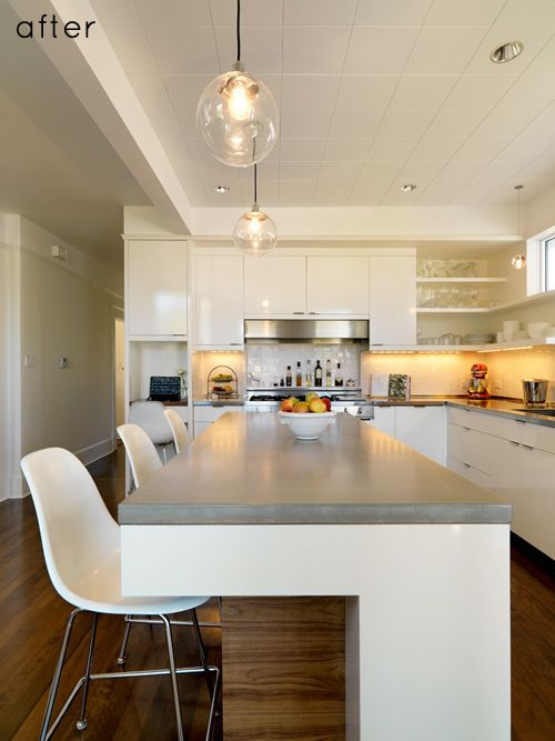 Amazing kitchen transformation, concrete  counters and unique island treatment and finishes.