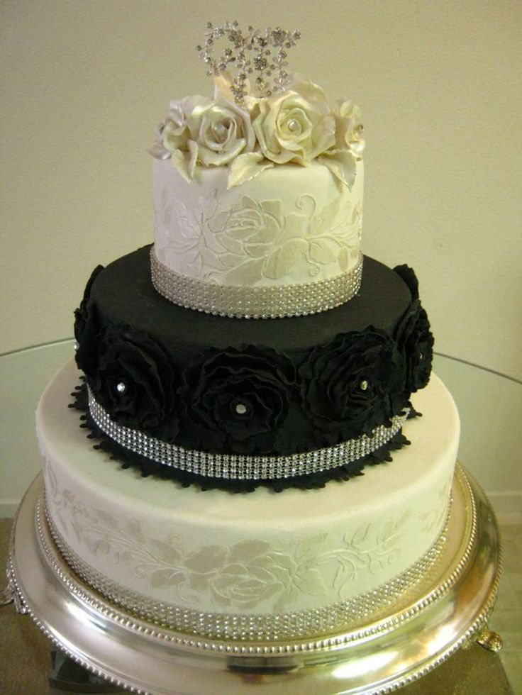 Black And White Bling Wedding Cake Fondant with royal icing stenciled sides, black ruffled fondant roses, gumpaste roses on top with a...