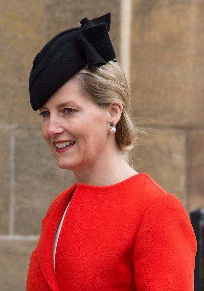 The Countess of Wessex paired her eye catching SPORTMAX red coat with a JANE TAYLOR black beret based percher hat.
