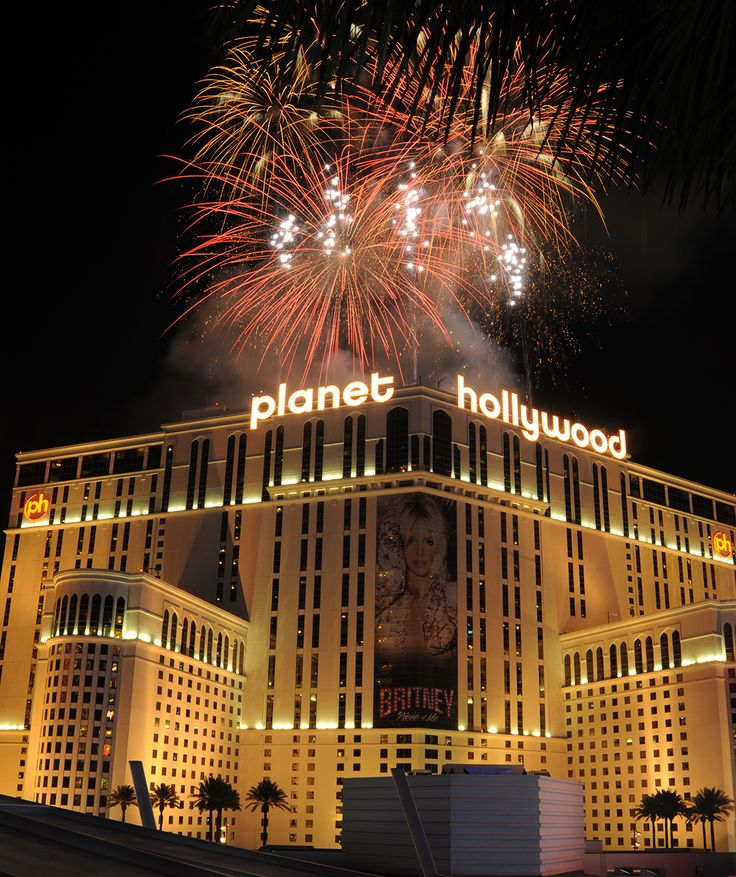 Fireworks burst over Planet Hollywood on the Las Vegas Strip at midnight on New Year's 2014, as seen from the The Cosmopolitan of Las Vegas. Las Vegas officials expect to welcome approximately 335,000 visitors for the holiday. Wednesday, January 1, 2014. (Photo/Las Vegas News Bureau, Glenn Pinkerton)