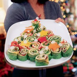 Wrap 'n' Stack Sandwich Tree Recipe. Mini Sandwiches made of whole-berry cranberry sauce, spinach-flour tortillas, mayonnaise, Monterrey Jack or American cheese, smoked turkey, green-leaf lettuce. Garnish with red & yellow bell peppers cut in to stars & cocktails onions for ornaments. Could also add green olives in addition to or in lieu of onions.