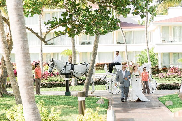 Bride Sara and her father disembark from the enchanting horse-drawn carriage at Moon Palace Cancun #FairytaleWedding