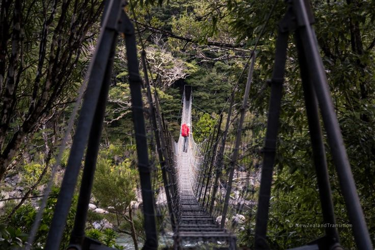 tramper on the Swing bridge over Waiohine River