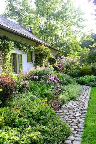 Garden of Dina Deferme; love the cobblestone pathways, and the lime green shutters. beautiful gardens!