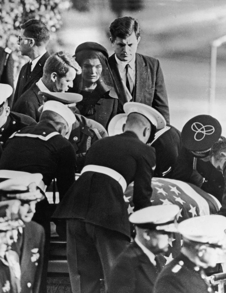 Jackie with Bobby and Ted Kennedy at the funeral of her husband