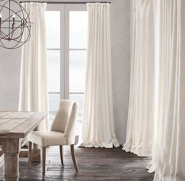 Beautiful Drapes from Restoration Hardware! Head on over to The ART of Domesticity for some ideas on how to choose and style your drapes.