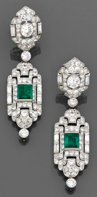 A Pair of Art Deco diamond, emerald and platinum and gold pendant earrings, circa 1930. Of Persian design, each set with brilliant-cut and baguette diamonds, the pendant centring a square-shaped emerald, suspending an articulated bezel-set diamond. #ArtDeco #earrings