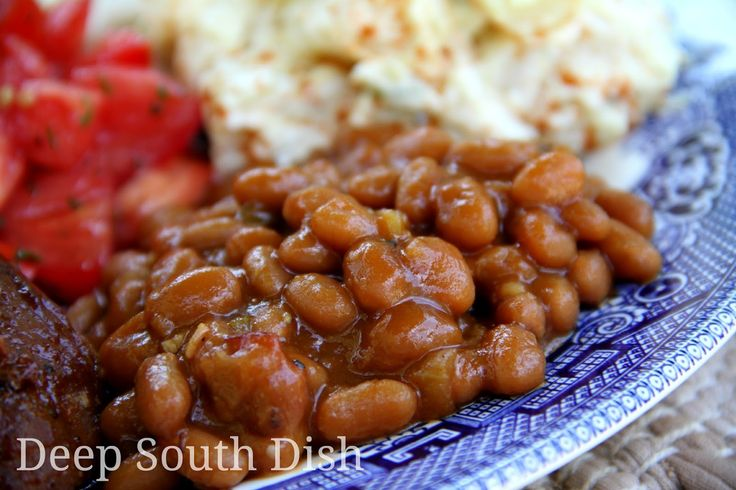 Southern Style Baked Beans - Southern seasoned baked beans with chili sauce, mustard, brown sugar, bacon, onion and bell pepper - theyre a cookout tradition! Pictured here with grilled ribs, Mamas Southern potato salad and marinated tomatoes.