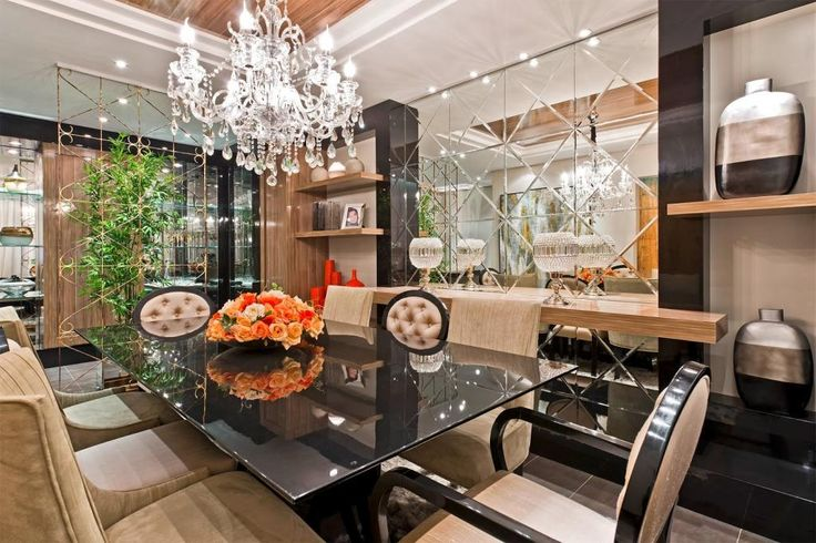 http://www.drissimm.com/wp-content/uploads/2014/12/luxury-crystal-chandelier-above-glass-dining-table-plus-beige-dining-chair-along-with-mirror-decoration-on-the-wall-betweeen-wooden-shelves-including-plant-indoor-in-the-nearby.jpg