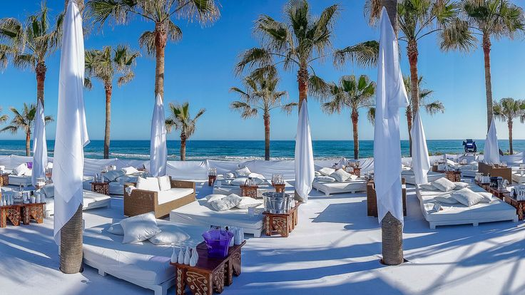 Nikki Beach Marbella, Spain beach club, Nikki Beach's Marbella outpost offers white day-beds, plenty of palm-trees, open-air fine-dining, live music and DJs in its outdoor restaurant.