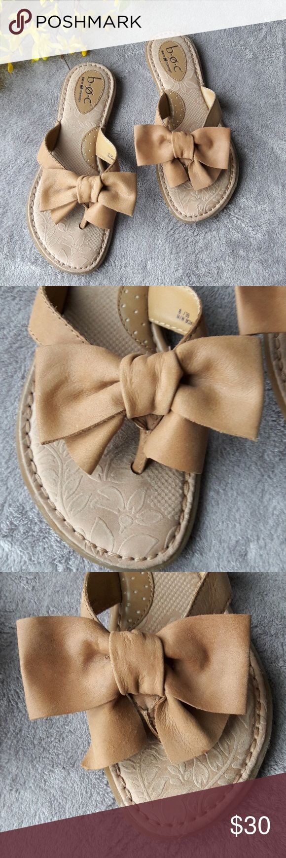Born B.O.C. Leather Bow Flip Flops Sandals A cute pair of sandals from BOC Born Concept. A tan color with a floral base. A leather bow adorns the straps. A few small marks.   Size 8  Leather Upper b.o.c. Shoes Sandals