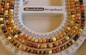 Creating a multi-strandnecklace.  Instruction includes using bead board for design.  Links to other projects.  #beading #jewelry #tutorial