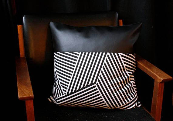 //product details// Faux leather pillow cover, with a panel of modern printed material. The back of the pillow is finished in a black backing, and the zipper closure is hidden. The pillow cover is 18x18. We recommending sizing up the pillow insert 1 or 2 sizes to really fill the
