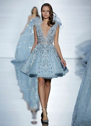 A-line, fitted dress with plunging décolleté in blue silk tulle and flower applique