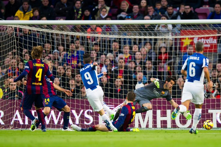 Sergio Garcia of RCD Espanyol scores the opening goal during the La Liga match between FC Barcelona and RCD Espanyol at Camp Nou on December 7, 2014 in Barcelona, Catalonia.