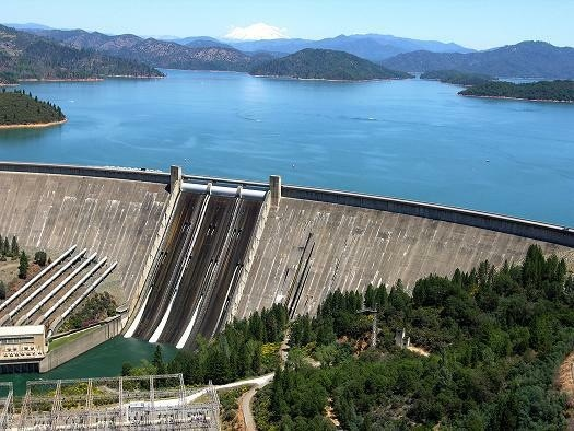 Shasta Lake/ Shasta Dam Shasta Lake, Shasta Dam, and Mt. Shasta can all be seen in this aerial photo. Shasta Lake is the largest lake in California, and offers visitors their own little piece of paradise on a houseboat, ski boat, or waverunner.