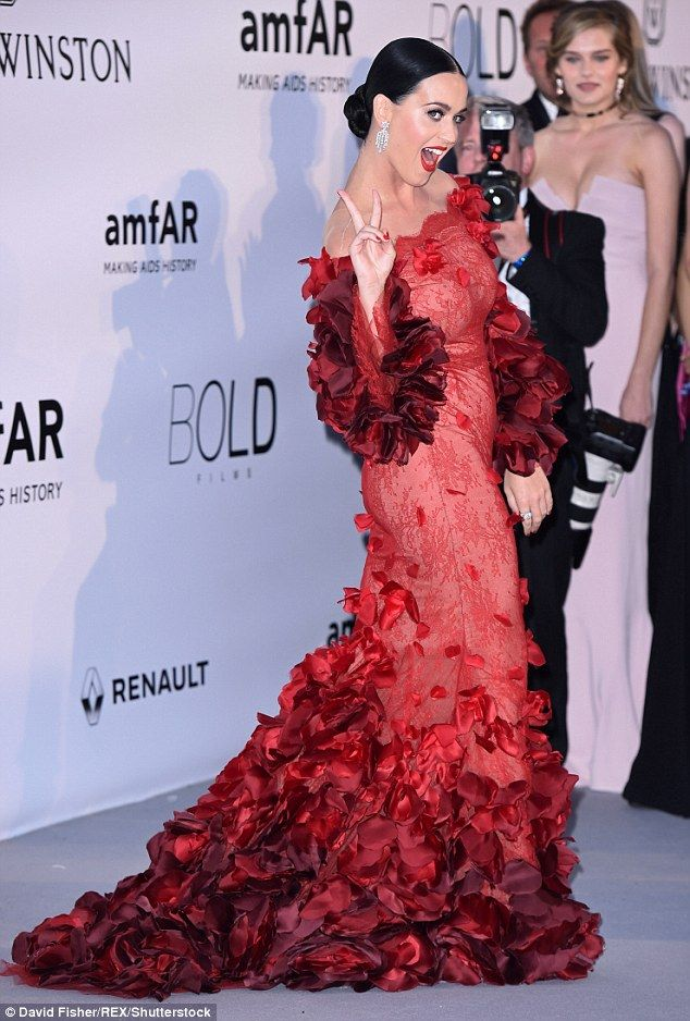 Peace of me: Katy flashed a peace sign on the red carpet as she headed into the star-studd...