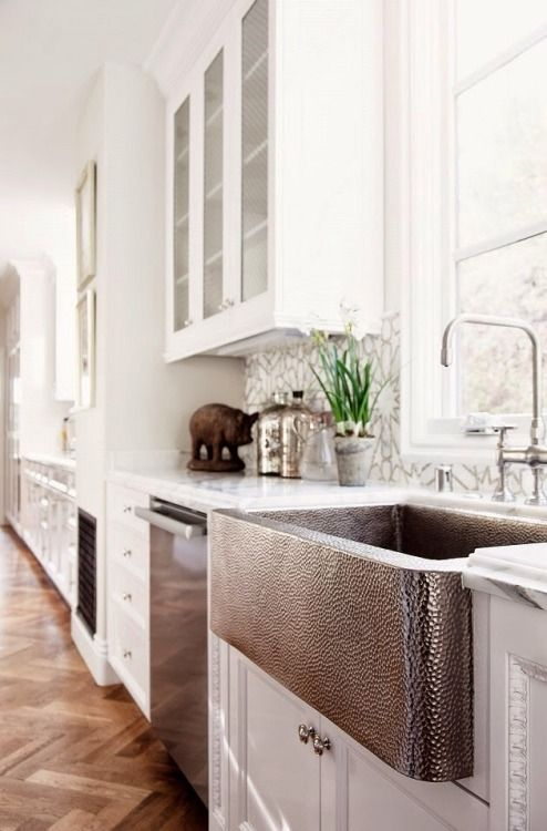 white kitchen with copper sink