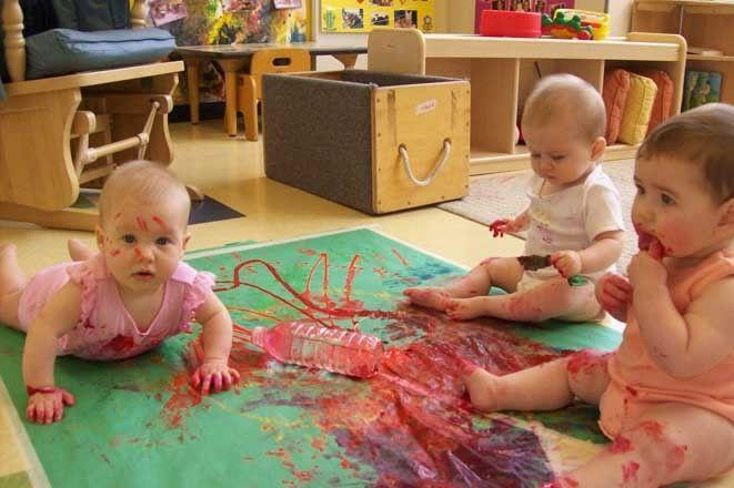 Babies explore paint at a nido, Reggio Emilia