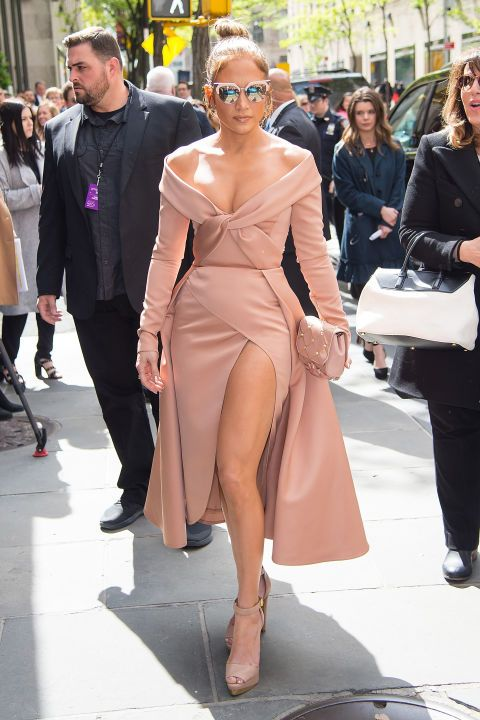 Jennifer Lopez showed some skin in a nude Elie Saab dress while out in New York City during NBC Upfronts.