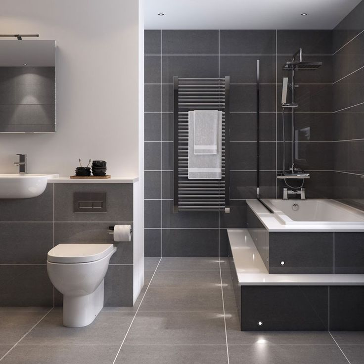 Bathroom Tile Idea - Use Large Tiles On The Floor And Walls (18 Pictures) | Large dark grey tiles surrounded by white grout and white appliances makes this bathroom look clean, sleek, and relaxing.