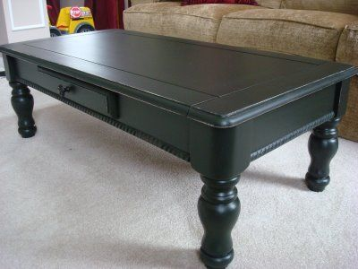 "Redoing a Goodwill Coffee Table - in black-""I am LOVING a black paint from Behr (shock) called Black Suede.""--Eggshell finish"