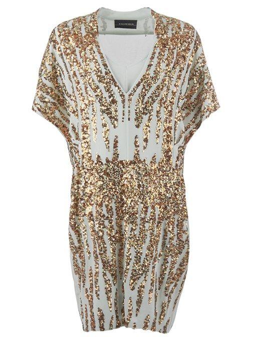 Fantastisk klänning med paljetter från By Malene Birger. Avslappnad modell med v-ringning framtill och kort ärm.