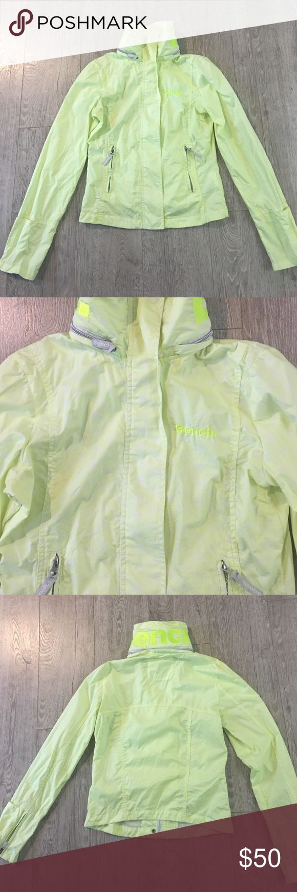 Bench jacket Bright yellow Bench windbreaker type jacket. Says bench on front and on the back of collar. There is a hood that rolls into the color of you are not wanting to use it. Super condition. Size small. Bench Jackets & Coats
