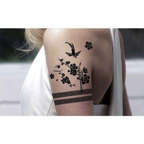 Tatuaggi bracciali donna - Tatuaggio a bracciale doppio con fiori