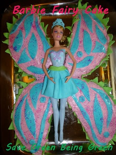 Make a Barbie Fairy Cake using 2 round cakes and a combination of frosting and fondant and used a Barbie in the Pink Shoes doll