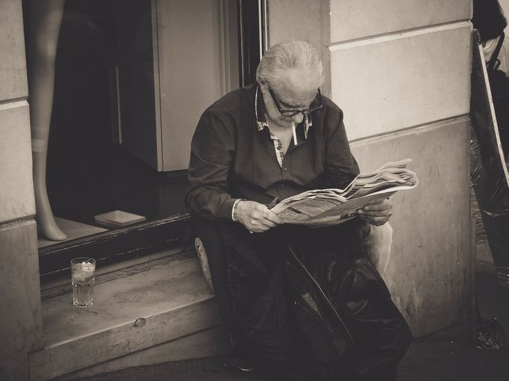reading the newspaper by george otoiu on 500px