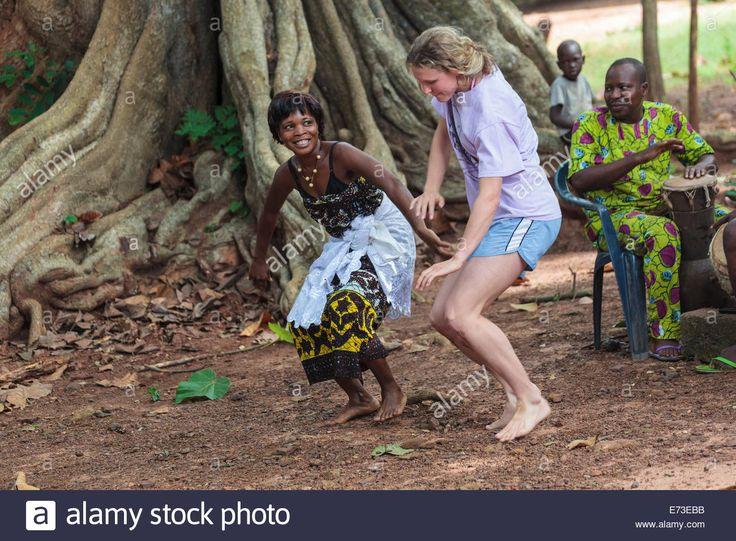african women dancing | Africa, Benin, Ouidah. Local woman dancing with tourist during voodoo Stock Photo, Royalty Free ...
