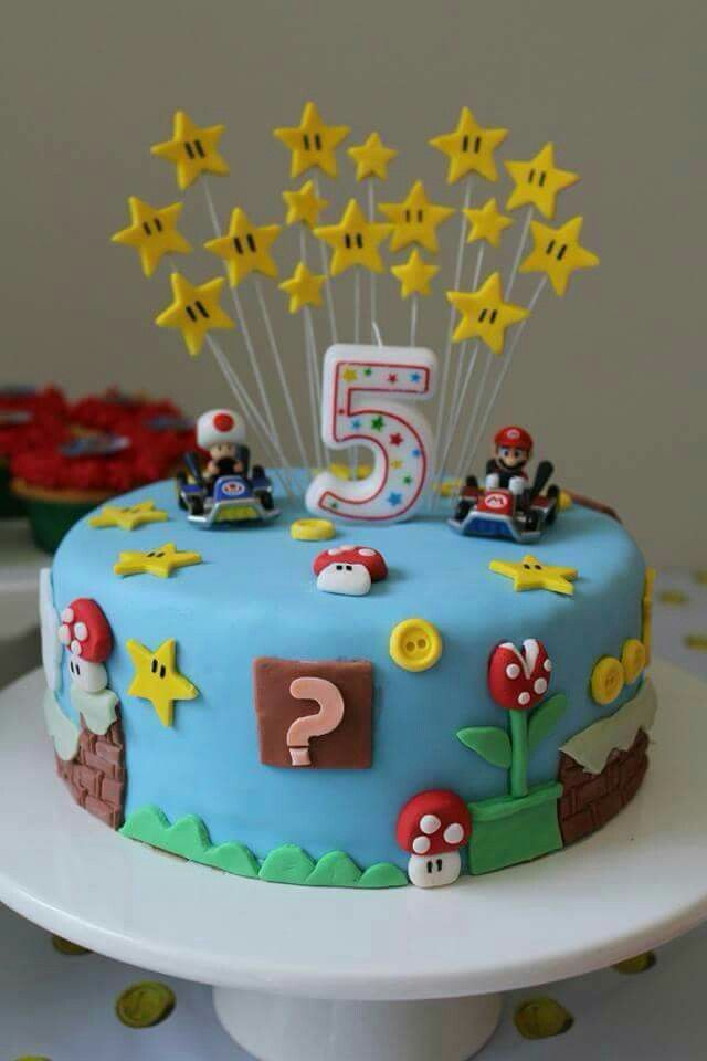 Likes the stars on top of this cake - put them on top of other cake. Mario kart cake