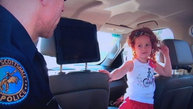 "When her 3-year-old daughter unbuckled the seatbelt to her car seat during a temper tantrum, Michelle Fortin decided to call for backup. The mother, who was driving her two kids home from the dentist at the time, tried explaining to her ""spunky"" little girl when they got home why she needs to wear a seatbelt. But she feared her lesson wouldn't stick. So, she called the Scottsdale Police Department's non-emergency line for assistance."