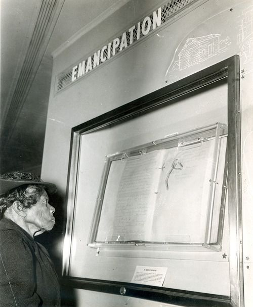 This remarkable photograph shows the then oldest living ex-slave, Mrs. Sally Fickland, viewing the Emancipation Proclamation in the Freedom Train at Philadelphia, on September 17, 1947.
