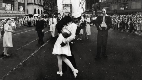 It is an image that captured an epic moment in U.S. history - a sailor locked in a passionate kiss with a nurse in New York City's Times Square at the end of World War II.  And, after decades of dispute, the couple in the 1945 photograph were revealed to be 89-year-olds George Mendonsa and Greta Zimmer Friedman.  Now the couple who won the nation's heart have reunited in the location of the famous smooch to reflect on the photograph that came to symbolize the end of the war.